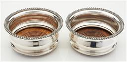 Sale 9123J - Lot 233 - A good quality pair of silverplate on copper deep bottle coasters, the oak base with concentric turned rings centred by a vacant sil...