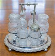 Sale 8402H - Lot 43 - An EP and etched glass cruet set comprising six bottles on a plated stand (damages)