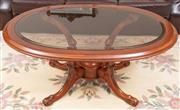 Sale 8926K - Lot 47 - A mahogany oval glass topped coffee table, W 123cm x D61cm X H 54cm