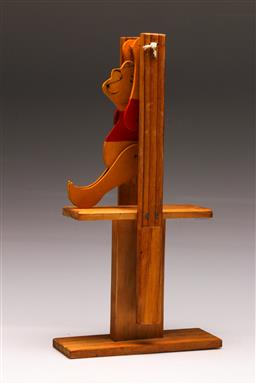 Sale 9128 - Lot 55 - A timber Winnie the pooh toy acrobat H:39cm