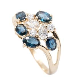 Sale 9253J - Lot 375 - A 14CT GOLD SAPPHIRE AND DIAMOND RING; a cluster of  5 oval cut blue sapphires totalling approx. 1.51ct, 3 round brilliant cut and 2...