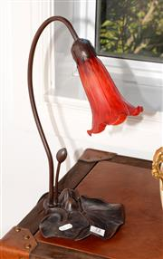 Sale 8098A - Lot 72 - An Art Nouveau style Lilly lamp with a red art glass shade
