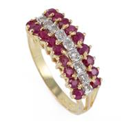 Sale 8866 - Lot 514 - A 14CT GOLD RUBY AND DIAMOND RING; stepped mount set with 18 rubies and 9 single cut diamonds, size N, wt. 2.92g.