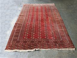 Sale 9162 - Lot 1094 - Vintage Bokhara Wool Carpet, with five columns of guls & wide end borders, in typical deep red & cream tones (314 x 215cm)