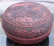 Sale 8800 - Lot 114 - An antique Chinese cinnabar lacquer carved circular covered bowl, D 32cm, purchased in London