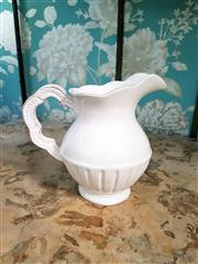 Sale 8500A - Lot 71 - A Portuguese style small cream porcelain water jug - Condition: As New - Measurements:  17cm high