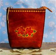 Sale 8577 - Lot 166 - A boho style hand tooled leather Hawaiian crossbody bag, new with tags, W 18 x H 20cm