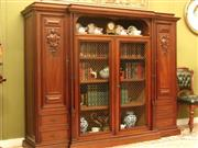 Sale 8925H - Lot 11 - A large antique French walnut breakfront floor bookcase. Fine carving, bronze mesh to doors (can be dismantled for transport), Heigh...