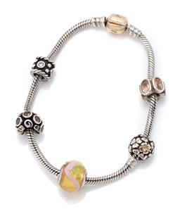 Sale 9107J - Lot 365 - A SILVER AND 14CT GOLD PANDORA CHARM BRACELET; sterling silver snake link chain with gold clasp attached with 5 charms incl 3 set wi...