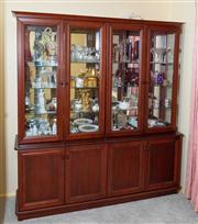Sale 8774A - Lot 411 - A Mahogany veneered buffet and hutch with glass shelved interior and doors above four doors, with lighting.