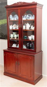Sale 8926K - Lot 63 - A Mahogany stained book case with two glass panelled doors, H 208 x W 106 x 47cm