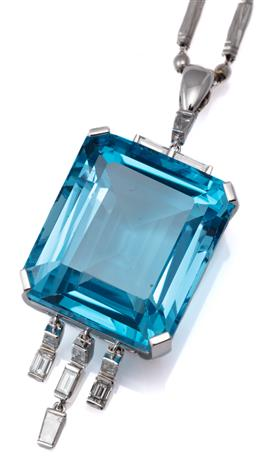 Sale 9124 - Lot 385 - A RETRO STYLE TOPAZ AND DIAMOND PENDANT NECKLACE; featuring a large emerald cut blue topaz of approx. 58ct in 18ct white gold to tas...