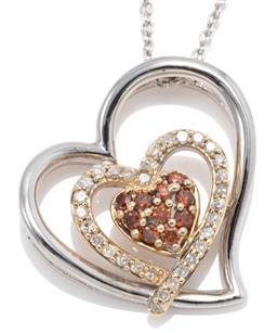 Sale 9169 - Lot 391 - A GOLD AND SILVER TRIPLE HEART PENDANT NECKLACE; featuring a 10ct gold heart shape cluster set with 10 round brilliant cut brown dia...