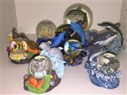 Sale 8338A - Lot 163 - A group of snow globes, including dolphins and fish