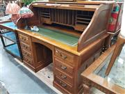 Sale 8744 - Lot 1034 - Timber Roll Top Desk with Leather Inlaid Top