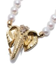 Sale 8974 - Lot 381 - AN 18CT GOLD ELEPHANT AND PEARL NECKLACE; composed of 64 cultured pearls, 6.3 - 6.6mm round of good colour and lustre centring a 32...