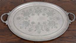 Sale 9134H - Lot 32 - A large twin handled floral decorated silver plated tray, on raised feet. Length 74cm