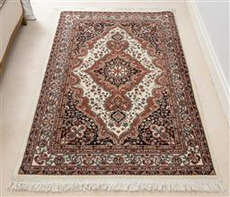 Sale 9140H - Lot 100 - A machine made Persian style rug with a pink and cream central medallion, Length 183cm x 121cm