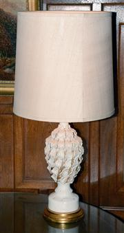 Sale 8015A - Lot 40 - A ceramic and brass table lamp with applied leaf decoration and cream shade.