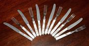 Sale 8107B - Lot 57 - 6 place settings of Oyster forks and knives with Mother of Pearl handles