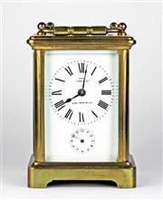 Sale 8402W - Lot 57 - A STRIKING BRASS CARRIAGE CLOCK; of customary form with white dial signed Wynne Co. Gloucester Rd SW. with Roman numerals bevelled g...