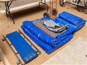 Sale 8677A - Lot 89 - A group lot including an undercar skate, a large quantity of oversized tarps, and a furniture trolley