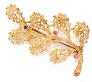 Sale 8905J - Lot 305 - A 14CT GOLD STONE SET BROOCH; leaf motif set with 3 small pink rubies, length 50mm, wt. 7.55g.