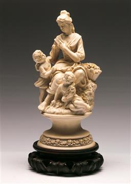 Sale 9128 - Lot 59 - A composite figural group of mother and children on timber base, (H:35cm)