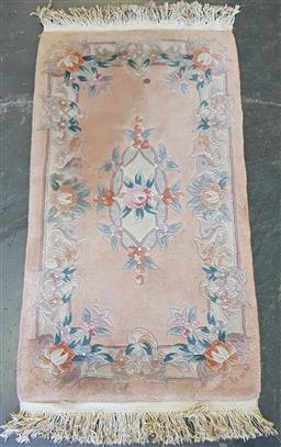 Sale 9174 - Lot 1341 - Chinese embossed pink rug with floral motifs (130 x 68cm)