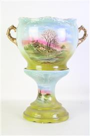 Sale 8905S - Lot 697 - A Stoke on Trent jardiniere on stand. Height 47cm