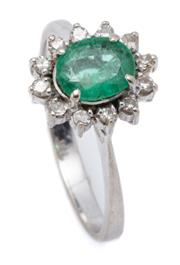Sale 9020 - Lot 308 - A 14CT WHITE GOLD EMERALD AND DIAMOND CLUSTER RING; centring on an oval cut emerald surrounded by 12 single cut diamonds, size O,  t...