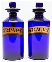 Sale 9054E - Lot 5 - A pair of cobalt blue Victorian medicine bottles and stoppers bearing painted labels for syrup of Papav and Aurant (poppy and orange...