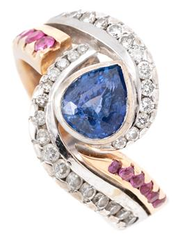 Sale 9168J - Lot 347 - A TWO TONE 18CT GOLD SAPPHIRE DIAMOND AND RUBY RING; centring a rub set pear cut blue sapphire of approx. 1.10ct between wrap around...