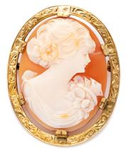 Sale 8905J - Lot 333 - A 15CT GOLD SHELL CAMEO BROOCH; set with a carved portrait cameo in a finely engraved frame, 37 x 29mm, wt. 10.8g.