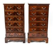 Sale 9015J - Lot 165 - A matching pair of Georgian style English mahogany vintage narrow 6 drawer chests C:1960. The flame panelled and cross banded tops o...