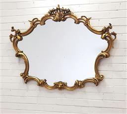 Sale 9097 - Lot 1061 - Rococo Style Gilt Mirror, the scroll frame surmounted by a rocaille (100 x 130cm)