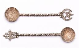 Sale 9119 - Lot 158 - A pair of Islamic sterling silver coffee spoons (L:12cm)