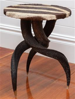 Sale 9134H - Lot 69 - A horn tri legged occasional table with zebra hide top, Height 46cm x Diameter 37cm