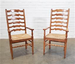 Sale 9166 - Lot 1018 - Pair of elm ladder back carvers with rush seats (h:100 x w:55 x d:47cm)