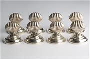 Sale 8518A - Lot 4 - A set of 8 silver plate Shell form place card holders, Ht: 4cm