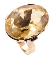 Sale 8905J - Lot 359 - A 9CT GOLD RETRO QUARTZ COCKTAIL RING; featuring an oval cut smoky quartz of approx. 26ct to 3.9mm wide band, size N, wt. 10.8g.