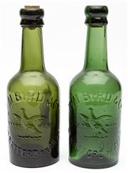Sale 9054E - Lot 8 - A pair of R.M. Bird & Co (Stratford on Avon) green glass drink bottles. Height 21cm