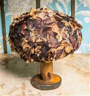 Sale 8577 - Lot 170 - A vintage brown feather hat, diam 18cm, Condition: Good internal lining stained