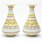 Sale 8620A - Lot 12 - A pair of continental porcelain spill vases of circular form, the averted tops to a slender graduated body and bulbous base on ring...
