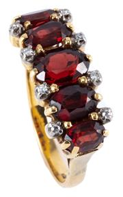 Sale 8974 - Lot 346 - AN 18CT GOLD GARNET AND DIAMOND RING; high claw set with 5 graduated oval cut garnets between 8 single cut diamonds, size P - Q, top...