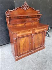 Sale 9068 - Lot 1021 - Victorian Mahogany Chiffonier, the carved back with supported shelf, above two frieze drawers & two arched panel doors, enclosing a...