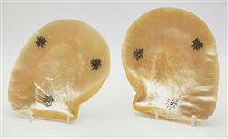 Sale 9123J - Lot 279 - A pair of polished mother of pearl shell dishes C: 1920's, each enhanced with silver symbols for long life and good luck and raised ..