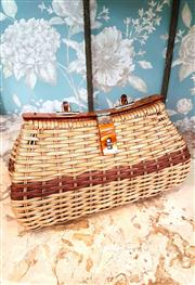 Sale 8577 - Lot 171 - A 1950s vintage Oggi Domani Europe wicker weave basket handbag featuring lucite handles and clasp and goldtone/ leather hardware,...