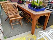 Sale 8740 - Lot 1256 - Teak Seven Piece Outdoor Setting incl. Table & Six Chairs