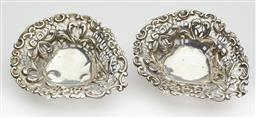 Sale 9123J - Lot 278 - A pair of antique English hallmarked sterling silver dishes, J Millward Banks, Birmingham 1896, the elaborately pierced and embossed...